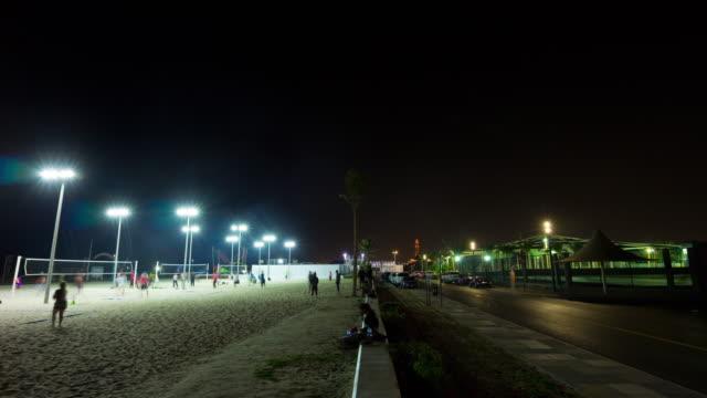 united arab emirates night dubai city famous jumeirah beach park traffic panorama 4k time lapse uae video