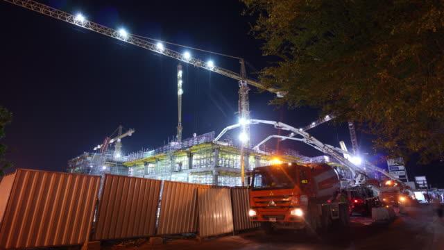 united arab emirates night dubai city hotel working  construction side panorama 4k time lapse uae video