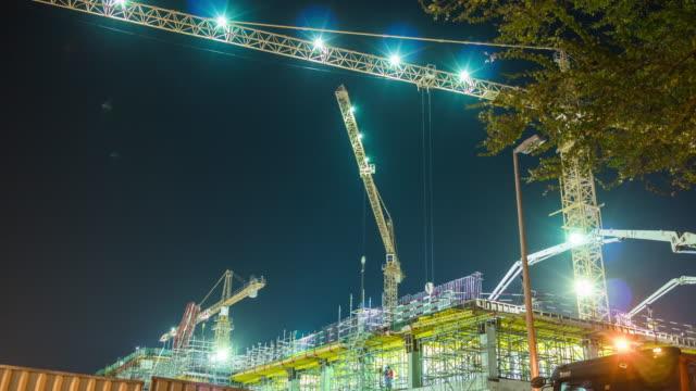 united arab emirates night illuminated dubai city jumeirah beach hotel working construction 4k time lapse uae video