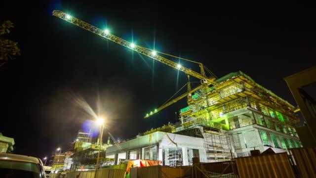 united arab emirates night illuminated dubai city jumeirah road working construction 4k time lapse uae video
