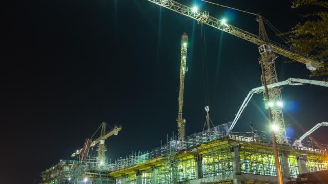 united arab emirates night illumination dubai city hotel construction working crane panorama 4k time lapse uae video