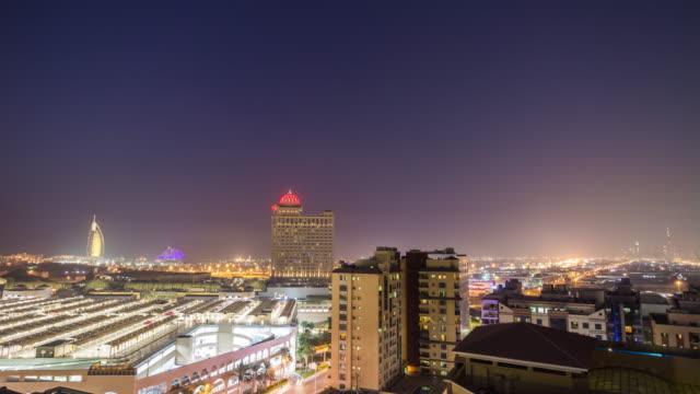 united arab emirates night illumination dubai cityscape al barsha rooftop panorama 4k time lapse uae video