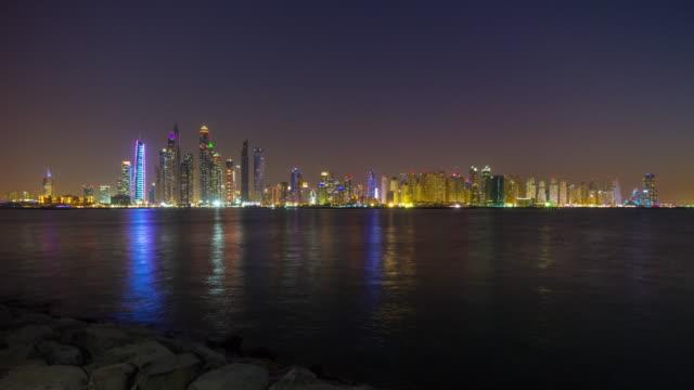 united arab emirates night illumination palm jumeirah famous dubai marina bay panorama 4k time lapse video