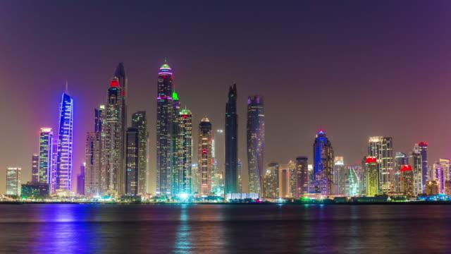 united arab emirates night sunset famous dubai marina bay palm panorama 4k time lapse uae video