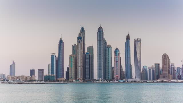 united arab emirates sunset dubai city marina bay famous palm view panorama 4k time lapse uae video