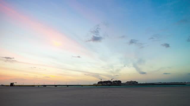 united arab emirates sunset sky dubai city beach island construction panorama 4k time lapse video