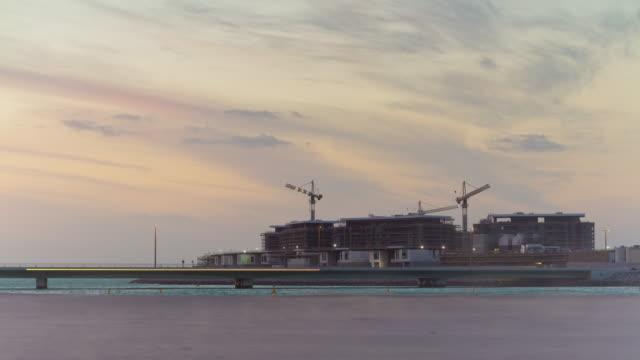 united arab emirates sunset sky jumeirah beach island construction panorama 4k time lapse video