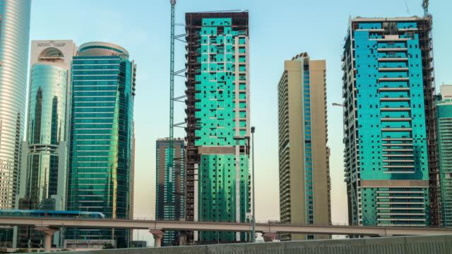 united arab emirates sunset twilight dubai city jbr traffic road jlt panorama 4k time lapse video