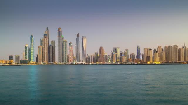 united arab emirates sunset twilight dubai marina bay palm famous panorama 4k time lapse video