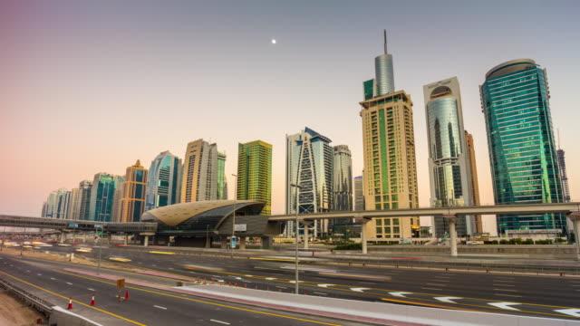 united arab emirates sunset twilight dubai marina jlt traffic road panorama 4k time lapse video