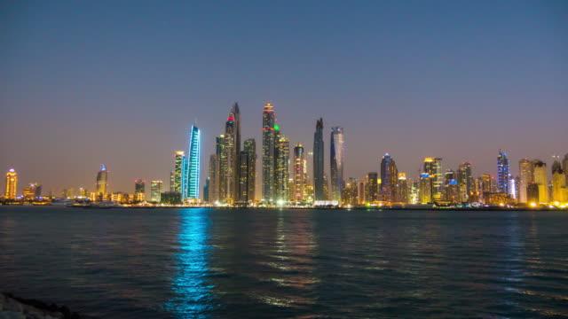 united arab emirates sunset twilight famous palm jumeirah dubai marina bay panorama 4k time lapse video