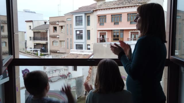united family clapping in the window - balcone video stock e b–roll
