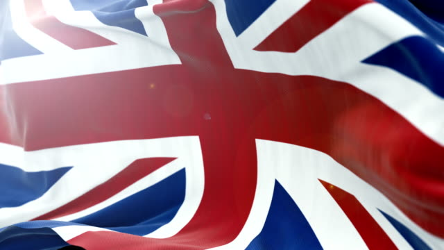 united kingdom flag slow waving background. 4k close up flag waving. seamless loop - politica e governo video stock e b–roll
