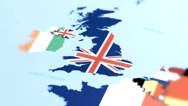 United Kingdom with National Flag on World Map tracking to United Kingdom with National Flag on World Map uk border stock videos & royalty-free footage
