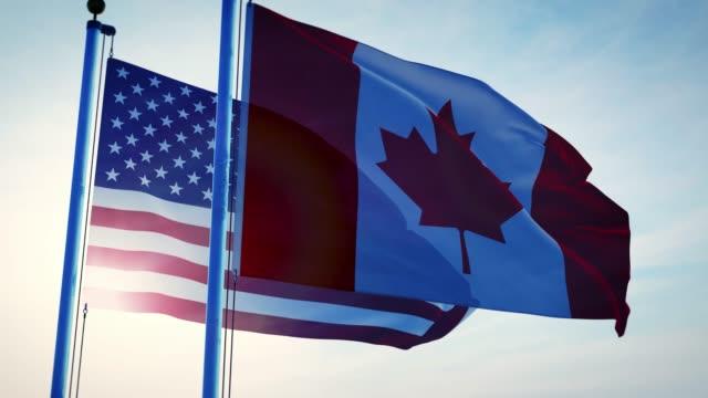 die flaggen der vereinigten staaten und kanadas zeigen amerikanische freundschaft, abkommen und zusammenarbeit. - vancouver kanada stock-videos und b-roll-filmmaterial