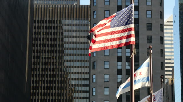 United States and Chicago Flags Waving on Chicago at Sunset video