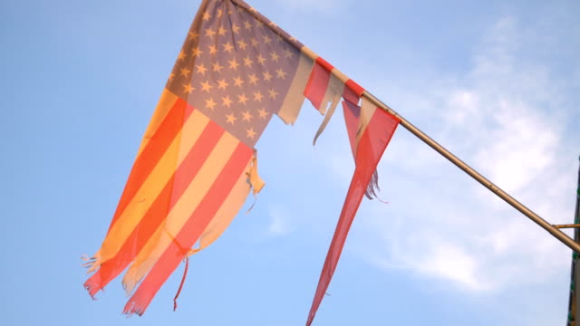 United States damage flag waving in the wind in 4K Professional video of United States damage flag waving in the wind in 4K torn stock videos & royalty-free footage
