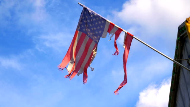 United States damage flag waving in the wind in 4K Professional video of United States damage flag waving in the wind in 4K Slow motion 60fps torn stock videos & royalty-free footage