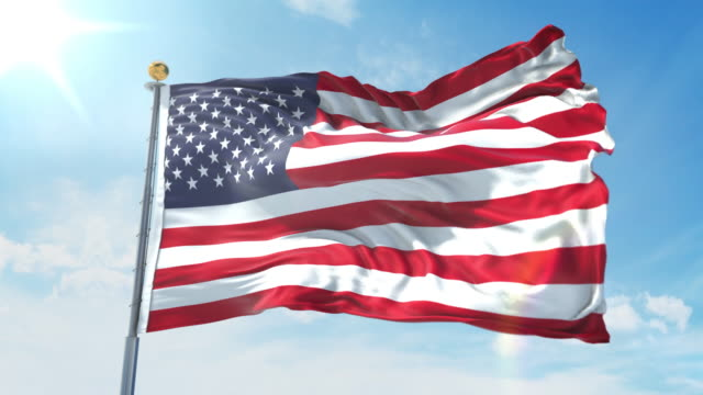 United States flag waving in the wind against deep blue sky. National theme, international concept. 3D Render Seamless Loop 4K