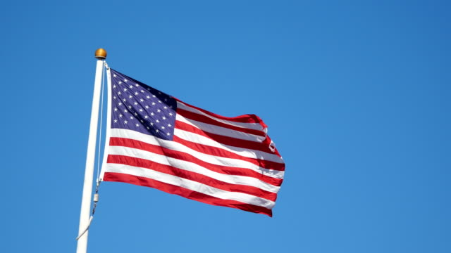 United States flag waving in the wind in 4K video