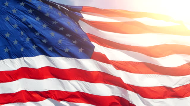 united states flag waving in the wind - politica e governo video stock e b–roll