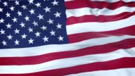istock United States flag waving in the wind with highly detailed fabric texture. Seamless loop 1203068603