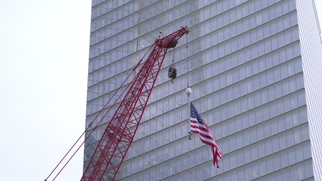 United States flag waving on the construction crane in New York in 4K slow motion 60fps video