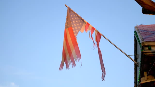 United States frayed flag waving in 4K slow motion 60fps video