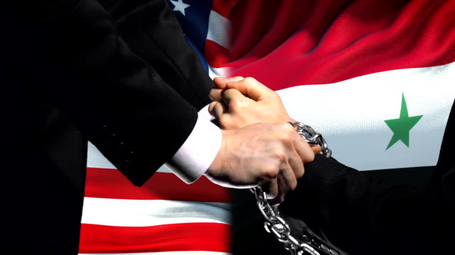 United States sanctions Syria, chained arms, political or economic conflict United States sanctions Syria, chained arms, political or economic conflict damascus stock videos & royalty-free footage