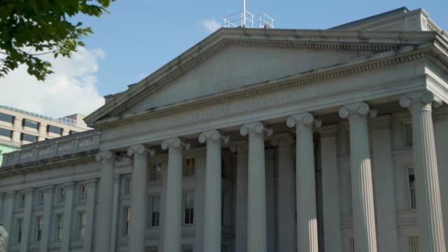 United States Treasury Department in Washington, DC - 4k/UHD - Tilt Up U.S. Treasury Department Building next door to the White House in Washington, DC treasury stock videos & royalty-free footage