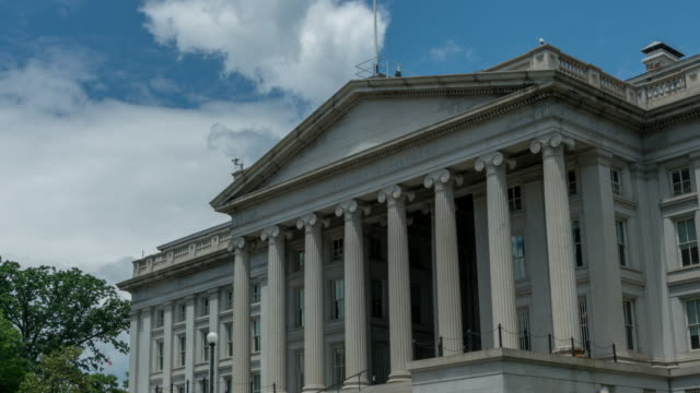 United States Treasury Department in Washington, DC - 4k/UHD - Zoom In U.S. Treasury Department Building next door to the White House in Washington, DC. Zoom In Time Lapse in 4k/UHD. treasury stock videos & royalty-free footage
