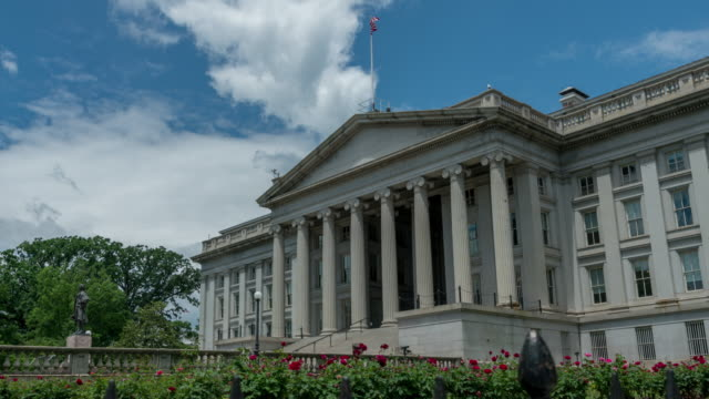 United States Treasury Department in Washington, DC - Time Lapse in 4k/UHD U.S. Treasury Department Building next door to the White House in Washington, DC. Time Lapse in 4k/UHD. treasury stock videos & royalty-free footage
