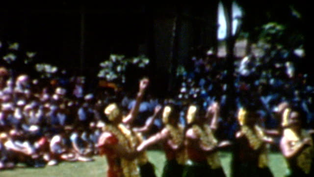 University of Hawaii Hula Dancers 1950's Hula dancers perform at a graduation ceremony at the University of Hawaii in the 1950's.  waikiki stock videos & royalty-free footage