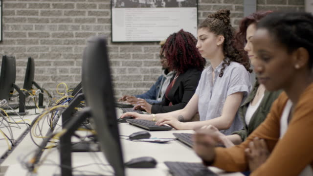 University students attend a computer course video