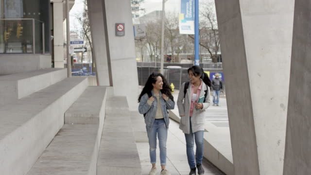University students walk to class together video
