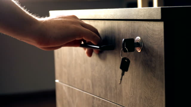 Unlocking and Opening Drawer in Office