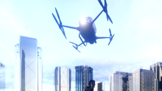 A unmanned passenger drone has flown in for its passenger. The concept of future unmanned aerial taxis. 3D rendering of animation. A unmanned passenger drone has flown in for its passenger. The concept of future unmanned aerial taxis. 3D rendering of animation. Produced in 4K. propeller stock videos & royalty-free footage