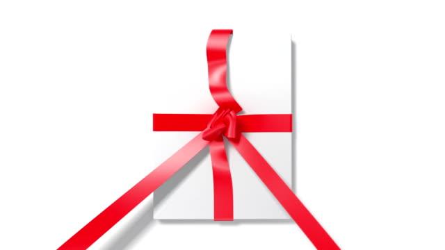 unpacking the present - ribbon stok videoları ve detay görüntü çekimi