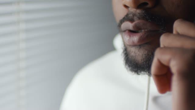 Unrecognizable Black Man Talking on Phone
