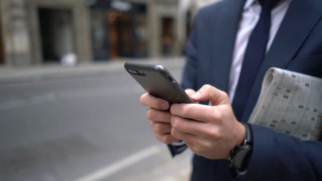 Unrecognizable business man chatting on his smartphone video