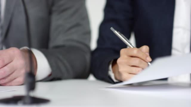 unrecognizable business partners signing document - appalti pubblici video stock e b–roll
