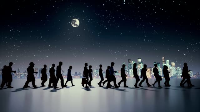 Unrecognizable business people silhouette walking at night video