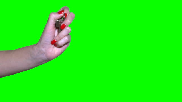 Unrecognizable businesswoman pass house key to man hand isolated on green video