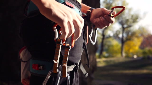 Unrecognizable climber wearing carabiners