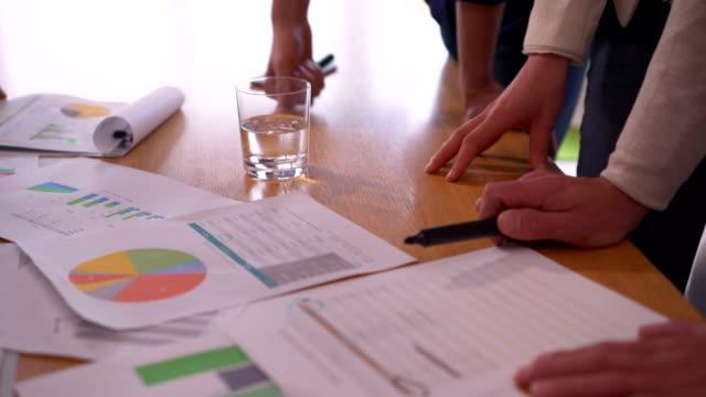Unrecognizable corporate team having a progress meeting. video