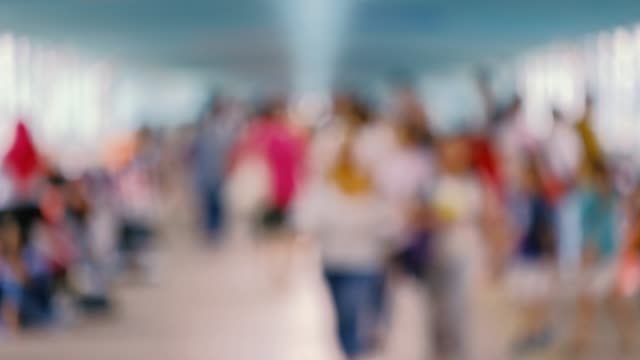 Unrecognizable crowd, people walking. Unrecognizable crowd, people walking. education stock videos & royalty-free footage