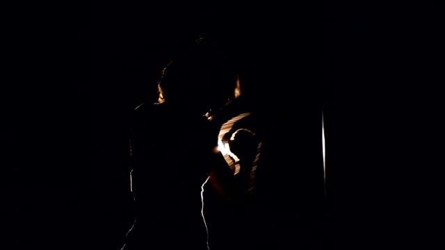 unrecognizable girl boxing with the punching bag. slowmotion. hd. - sacco per il pugilato video stock e b–roll