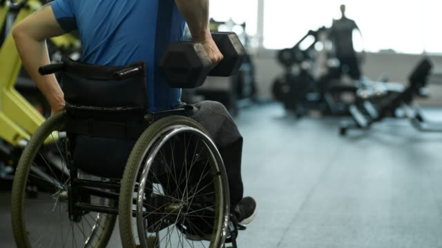 Unrecognizable Man in Wheelchair Doing One-Arm Rows video