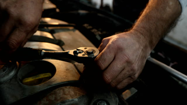 Unrecognizable mature Mechanic working Senior mechanic working at car service,fixing broken car,close up of human hands working on a car wrench stock videos & royalty-free footage