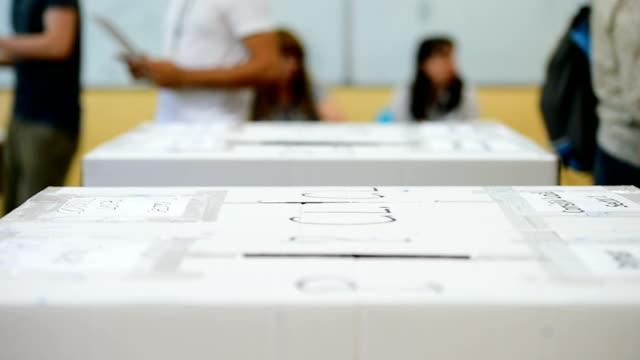 Unrecognizable people voting video